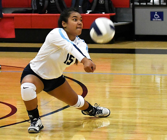 Enid's Evencilla Malolo returns a ball against Putnam City North Thursday, August 15, 2019 at the NOC Mabee Center. (Billy Hefton / Enid News & Eagle)