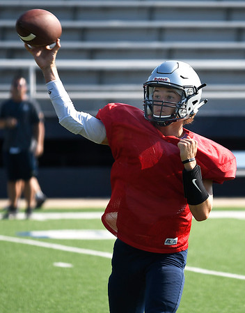 Enid's Maddux Mayberry throws a pass during the first practice in pads Friday August 16, 2019 at D. Bruce Selby Stadium. (Billy Hefton / Enid News & Eagle)
