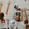 Enid's Catherine Cunningham hits the ball against Chisholm's Lydia Peace and Brooklyn Willson Tuesday, August 20, 2019 at the NOC Mabee Center. (Billy Hefton / Enid News & Eagle)