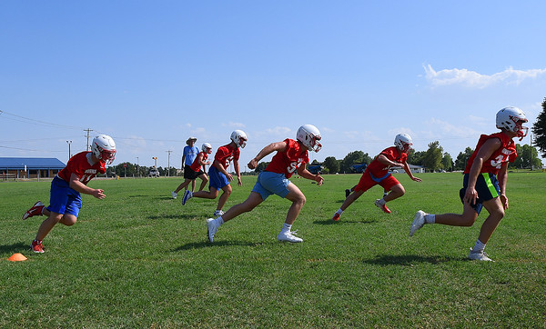 Chisholm High players take part in a pursuit drill during the first day of practice Monday, August 12, 2019 at Chisholm High School. (Billy Hefton / Enid News & Eagle)