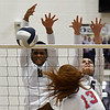 Enid's D'Dani Levy and Jacqueline Camarena block the shot of Chisholm's Lydia Peace Tuesday, August 20, 2019 at the NOC Mabee Center. (Billy Hefton / Enid News & Eagle)