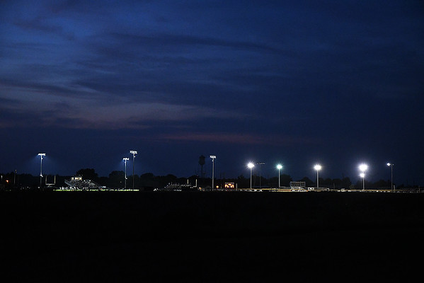 Lights from the Covington-Douglas high school football stadium light the evening sky plays as Timberlake and Covington-Douglas play the season opener at Covington-Douglas High School Thursday, August 29, 2019. (Billy Hefton / Enid News & Eagle)