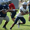Enid's Johnny Villa carries the ball during practice at D. Bruce Selby Stadium Tuesday, August 27, 2019. (Billy Hefton / Enid News & Eagle)