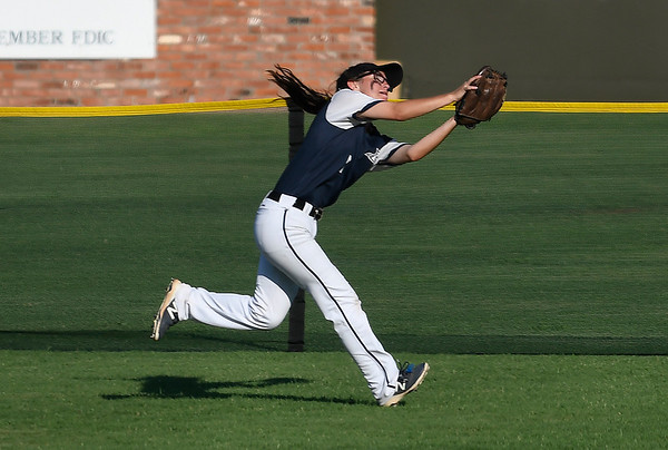 Enid's Mackenzie Sutton makes a running catch against Broken Arrow Tuesday, August 13, 2019 at David Allen Memorial Ballpark. (Billy Hefton / Enid News & Eagle)