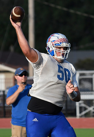 Cooper Wiedon of Waukomis throws a pass against Coyle during a scrimmage at Pond Creek-Hunter High School Friday, August 23, 2019. (Billy Hefton / Enid News & Eagle)
