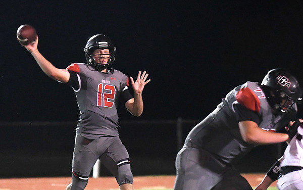 Oklahoma Bible's Baron Winter throws a pass against Oklahoma Christian Academy during the season opener Friday, Auguat 30, 2019. (Billy Hefton / Enid News & Eagle)