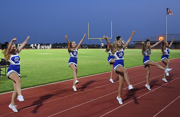 Covington-Douglas cheerleaders perform during halftime in the season opener against Timberlake at Covington-Douglas High School Thursday, August 29, 2019. (Billy Hefton / Enid News & Eagle)