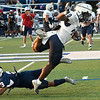 Enid's Trentavious Mitchell is upended by Jadon Dimarucut during an intersquad scrimmage Saturday, August 17, 2019 at D. Bruce Selby Stadium. (Billy Hefton / Enid News & Eagle)