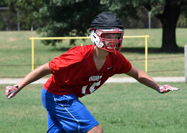 Chisholm's Nate Edwards goes through drills during practice at Chisholm High School Wednesday, August 14, 2019. (Billy Hefton / Enid News & Eagle)