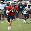 Enid's Maddux Mayberry looks for a receiver as he scrambles out of the pocket during an intersquad scrimmage Saturday, August 17, 2019 at D. Bruce Selby Stadium. (Billy Hefton / Enid News & Eagle)