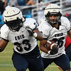 Enid's Johnny Villa follows the blocking of Luis Vega for a score during an intersquad scrimmage Saturday, August 17, 2019 at D. Bruce Selby Stadium. (Billy Hefton / Enid News & Eagle)