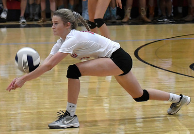 Enid's Gabby Bartley reaches low to volley the ball against Enid Tuesday, August 20, 2019 at the NOC Mabee Center. (Billy Hefton / Enid News & Eagle)