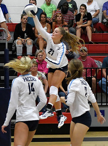 Enid's Catherine Cunningham hits the ball against Chisholm Tuesday, August 20, 2019 at the NOC Mabee Center. (Billy Hefton / Enid News & Eagle)