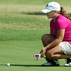 Megan Metcalf line up a putt on the 11th green Monday at Oakwood Country Club during the Enid City Junior Golf Championship. (Staff Photo by BILLY HEFTON)