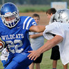 gage Smith of Covington-Douglas stiff arms a Timberlake defender Friday during a scrimmage in Jet. (Staff Photo by BILLY HEFTON)