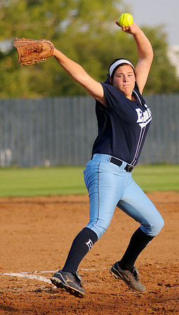 Enid's Ally Lewis hurls a strike toward a Stillwater Lady Pioneer Thursday at Pacer Field. Stillwater beat the Pacers 7-4. (Staff Photo by BONNIE VCULEK)