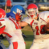 Kremlin-Hillsdale ball carrier runs against Waukomis Friday at Waukomis HIgh School during the opening game of the season. (Staff Photo by BILLY HEFTON)