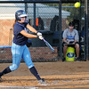 Enid's Courtney Chelf connects for a two-run home run in the bottom of the first inning against Stillwater Thursday at Pacer Field. Chelf's eleventh home run of the 2012 season broke her own record from last season. (Staff Photo by BONNIE VCULEK)