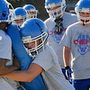 Members of the Waukomis High School football team go through drills Tuesday on the first day of official practice for high school teams across the state. (Staff Photo by BILLY HEFTON)