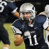 Enid's Seth handley runs the ball against Choctow Friday at D. Bruce Selby Stadium. (Staff Photo by BILLY HEFTON)