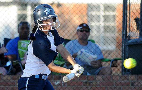 taylor Douglas connects on a RBI single against Edmond Memorial Monday at Pacer Field. (Staff Photo by BILLY HEFTON)