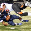 Enid's Chance Pryor is sacked for a loss by Tulsa Washington's Jordan Brailford Friday during the Plainsmen's homecoming game against the Hornets. (Staff Photo by BONNIE VCULEK)