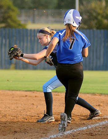 Enid's Claire Andrews retires the side with the third out in the top of the second inning against Stillwater Thursday, Sept. 20, 2012. (Staff Photo by BONNIE VCULEK)