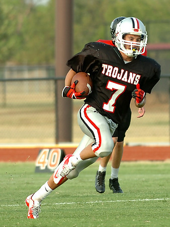 OBA's Tanner Roberts returns an interception during a scrimmage against Crossing Christian last week. (Staff Photo by BILLY HEFTON)