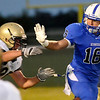Hennessey's Levi Hill runs against Kingfisher during the first half Friday at Hennessey High School. (Staff Photo by BILLY HEFTON)