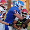 Jared Lawson of Waukomis wraps up a Kremlin-Hillsdale ball carrier Friday at Waukomis HIgh School during the opening game of the season. (Staff Photo by BILLY HEFTON)