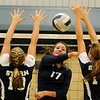 Grace Enmeier hits between OKC Storm blockers Monday at Waller Middle School. (Staff Photo by BILLY HEFTON)
