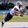 Christian Voitik makes a juggling interception against Bartlesville Friday at Bartlesville High School. (Staff Photo by BILLY HEFTON)