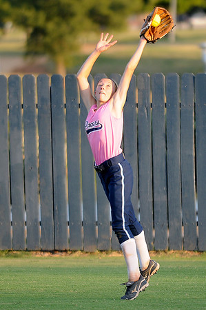 Shannon Mueller stretches to make a catch against Jenks Tuesday at Pacer Field. (Staff Photo by BILLY HEFTON)