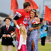 Chisholm High School football homecoming king Brady Nelson hugs homecoming queen Katelyn King Friday prior to the Longhorns' game against the Blackwell Maroons. (Staff Photo by BONNIE VCULEK)