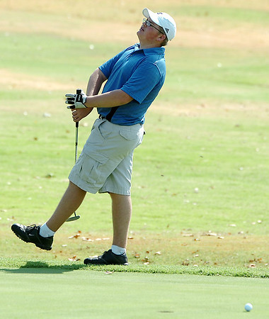 Trent Hoth reacts to missing a putt on the 18th green Monday at Oakwood Country Club during the Enid City Junior Golf Championship. (Staff Photo by BILLY HEFTON)