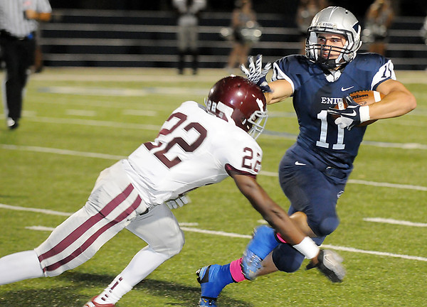 Enid's Seth Handley straight arms Robert Charlton of Edmond Memorial Friday at D. Bruce Selby Stadium. (Staff Photo by BILLY HEFTON)