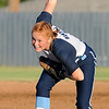 Katelynn Bennett begins her wind up as she pitches against Edmond Memorial Monday at Pacer Field. (Staff Photo by BILLY HEFTON)