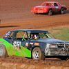 Hennessey's Heston Shaw has the lead before he takes the checkered flag during Factory Stock races Sunday at the Enid Speedway. Shaw's father, Harold, was the promoter for the race track in Enid. (Staff Photo by BONNIE VCULEK)