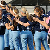 Enid Pacers' Courtney Chelf (left) greets her teammates as she is introduced before the game against the Stillwater Lady Pioneers Thursday, September 20, 2012 at Pacer Field. Chelf broke her own 2011 home run record of 10 during the bottom of the first inning with a two-run blast over the center field wall. The home run gave her 11 so far during the 2012 season. (Staff Photo by BONNIE VCULEK)