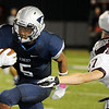 Enid's Johnny Lawrence pulls away from Colin Kettlesleger of Edmond Memorial Friday at D. Bruce Selby Stadium. (Staff Photo by BILLY HEFTON)