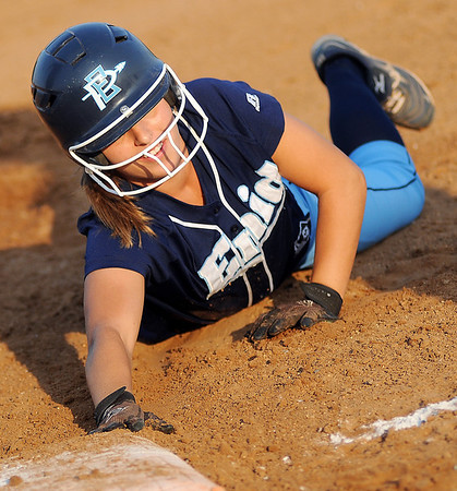 Enid's Abby Lee dives safely back to first during the Pacers' game against the Stillwater Lady Pioneers Thursday at Pacer Field. The Lady Pioneers defeated the Pacers 7-4. (Staff Photo by BONNIE VCULEK)