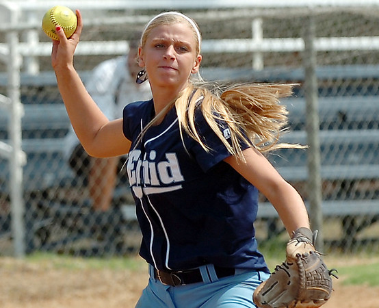 Lacey Hudson makes a throw to first against Sand Springs Thursday at Pacer Field. (Staff Photo by BILLY HEFTON)