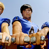 (left to right) Levi Hill, Car Aguire and Ocatvio Pina show their championship rings. (Staff Photo by BILLY HEFTON)