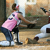 Taylor Douglas tags out a Jenks runner at home Tuesday at Pacer Field. (Staff Photo by BILLY HEFTON)