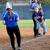 Enid's Abby Lee (right) fields the throw to first for a double out against the Stillwater Lady Pioneers Thursday, Sept. 20, 2012 at Pacer Field. (Staff Photo by BONNIE VCULEK)
