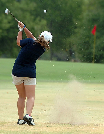 Megan Metcalf hits tee shot on the 8th hole at Meadowlake Golf Course Tuesday during the Enid City Junior Golf Championship. (Staff Photo by BILLY HEFTON)