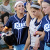 Courtney Chelf (left) celebrates her 2012 record-breaking, eleventh home run in the bottom of the first inning Thursday with her teammates at Pacer Field. Enid and the Stillwater Pioneers were tied 2-2 at the end of one. (Staff Photo by BONNIE VCULEK)