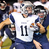 Seth Handley outruns a Bartlesville defender for a long gain Friday at Bartlesville High School. (Staff Photo by BILLY HEFTON)