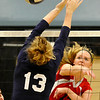 OBA's Brooke Wayman hits the ball pass Enid's Sarah Blakely Monday at Waller Middle School. (Staff Photo by BILLY HEFTON)