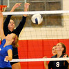 Enid Pacers' middle blocker Grace Enmeier scores over Moore Lady Lions' Peyton Franklin Tuesday during the Pacers' volleyball victory at the Mabee Center. (Staff Photo by BONNIE VCULEK)